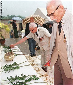Former POWs pay their respects at a Japanese War Cemetary